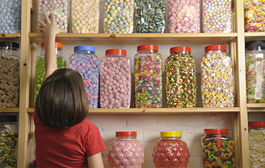How to help children curb their sweet tooth (without secretly raiding the candy bowl)